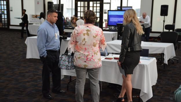 Vendor from Freedom Scientific meets with customers at Tech Showcase
